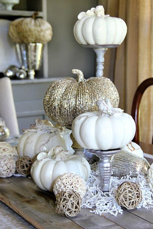 """<p>Elevate your entire table with this eye-catching centerpiece idea. It'll lift your guests' gazes upward, providing visual interest, height, and flair without requiring any over-the-top elements.</p><p><strong>Get the tutorial at <a href=""""https://thistlewoodfarms.com/five-fall-decorating-ideas-for-the-dining-room-and-a-giveaway/"""" rel=""""nofollow noopener"""" target=""""_blank"""" data-ylk=""""slk:Thistlewood Farms"""" class=""""link rapid-noclick-resp"""">Thistlewood Farms</a>.</strong></p><p><strong><a class=""""link rapid-noclick-resp"""" href=""""https://www.amazon.com/Dahlia-Studios-Mirrored-Birthday-Serveware/dp/B07QD145DX?tag=syn-yahoo-20&ascsubtag=%5Bartid%7C10050.g.2130%5Bsrc%7Cyahoo-us"""" rel=""""nofollow noopener"""" target=""""_blank"""" data-ylk=""""slk:SHOP SILVER CAKE STANDS"""">SHOP SILVER CAKE STANDS</a><br></strong></p>"""