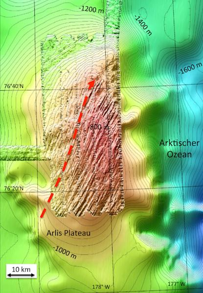 A bathymetric map of the Arctic's Arlis Plateau, with sets of different streamlined glacial lineations. The arrow marks the flow direction of ancient ice sheets.