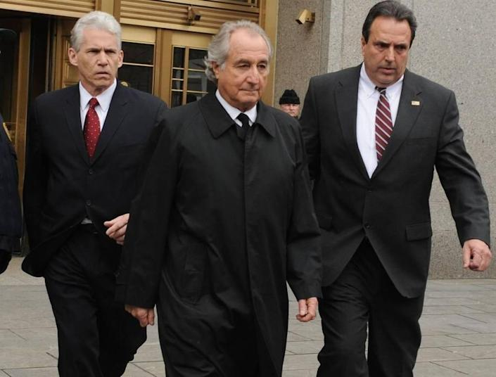 In this March 10, 2009, file photo, Bernard Madoff exits Manhattan federal court in New York. Federal regulators reached a settlement with Madoff on June 16, 2009, that prohibits him from working in the securities industry.