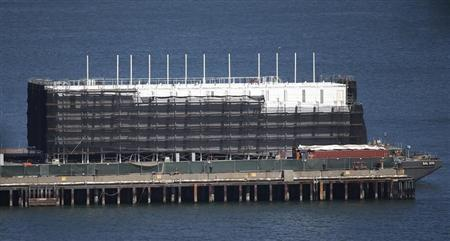 A barge built with four levels of shipping containers is seen at Pier 1 at Treasure Island in San Francisco, California October 28, 2013. How badly does Google want to keep under wraps a mysterious project taking shape on a barge in San Francisco Bay? Badly enough to require U.S. government officials to sign confidentiality agreements. REUTERS/Stephen Lam