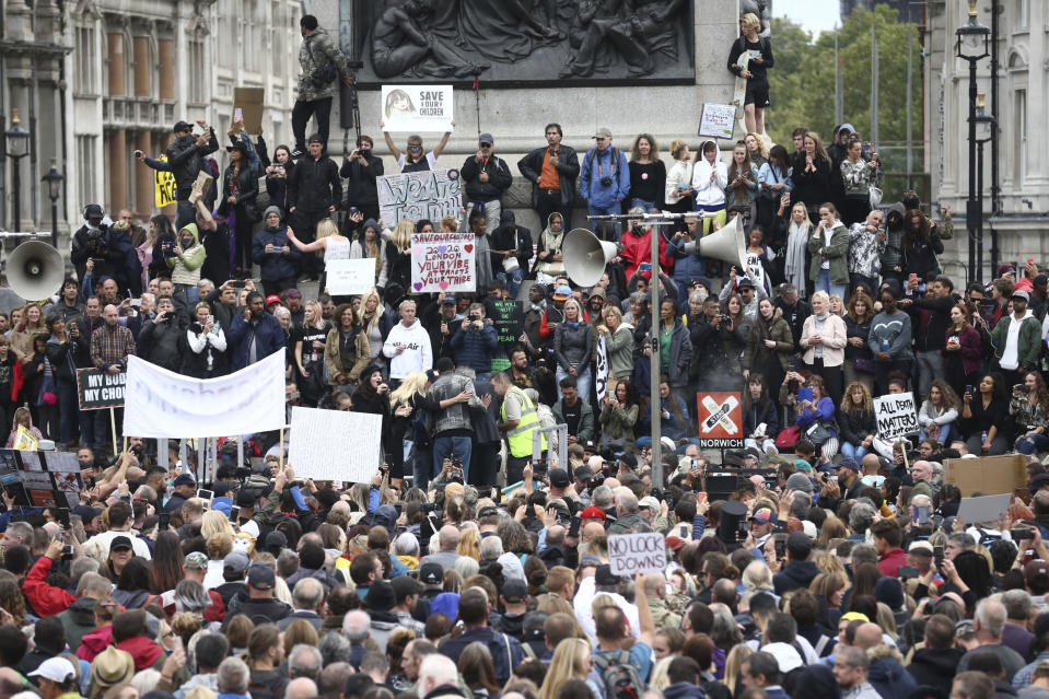 Protesters gather opposed to COVID-19 pandemic restrictions, in Trafalgar Square, London, Saturday, Aug. 29, 2020. This protest shows solidarity with a protest held in Germany where tens of thousands of people gathered at the German capital's iconic Brandenburg Gate in the morning before streaming down the Unter den Linden boulevard in a show of defiance against Germany's coronavirus prevention measures. (Yui Mok/PA via AP)