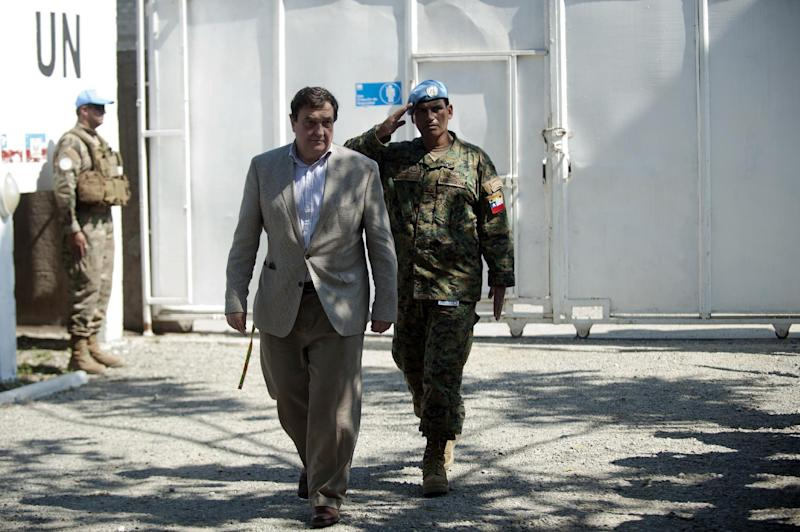 The President of United Nations Security Council Cristian Barros visits a base of the United Nations Stabilization Mission in Haiti (MINUSTAH) in Cap-Haitien, on January 24, 2015 (AFP Photo/Hector Retamal)