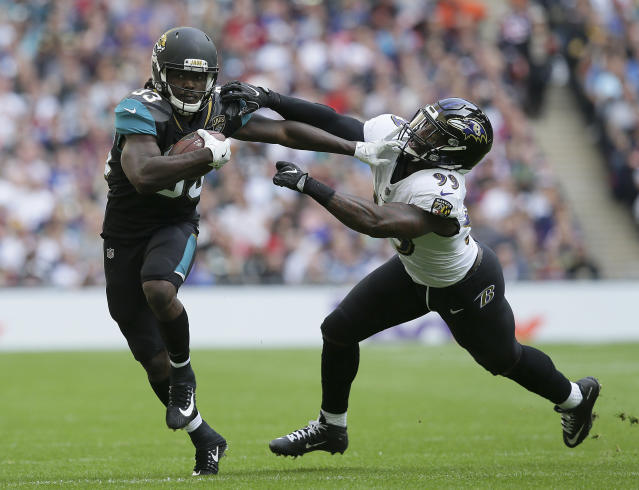 <p>Jacksonville Jaguars running back Chris Ivory (33) stiff arms Baltimore Ravens outside linebacker Matt Judon (99) during the first half of an NFL football game at Wembley Stadium in London, Sunday Sept. 24, 2017. (AP Photo/Tim Ireland) </p>