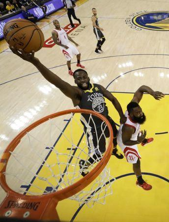 May 22, 2018; Oakland, CA, USA; Golden State Warriors forward Draymond Green (23) shoots the basketball against Houston Rockets guard James Harden (13) during the first half in game four of the Western conference finals of the 2018 NBA Playoffs at Oracle Arena. Mandatory Credit: Marcio Jose Sanchez/Pool Photo via USA TODAY Sports