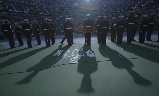 U.S. Marines preside over ceremonies ahead of the men's singles final match between Rafael Nadal of Spain and Novak Djokovic of Serbia at the U.S. Open tennis championships in New York, September 9, 2013. REUTERS/Eduardo Munoz (UNITED STATES - Tags: SPORT TENNIS MILITARY)