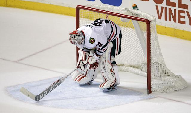 Chicago Blackhawks goalie Antti Raanta, of Finland, stands by the net after giving up the go-ahead goal to the Nashville Predators in the final minute of an NHL hockey game Saturday, April 12, 2014, in Nashville, Tenn. The Predators added an empty-net goal to win 7-5. (AP Photo/Mark Humphrey)
