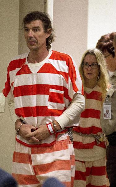 Paul and Sheila Comer are led into a courtroom for a hearing in Dallas, Ga., Thursday, Oct. 4, 2012. The Comers are accused of locking their teenaged son in a bedroom with little food for years. The Comers were arrested last month and accused of abusing 18-year-old Mitch Comer. He weighed 87 pounds when he was found in Los Angeles. (AP (AP Photo/John Bazemore)