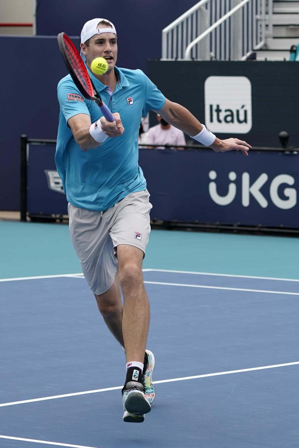 John Isner returns to Roberto Bautista Agut, of Spain, during the Miami Open tennis tournament, Tuesday, March 30, 2021, in Miami Gardens, Fla. (AP Photo/Marta Lavandier)