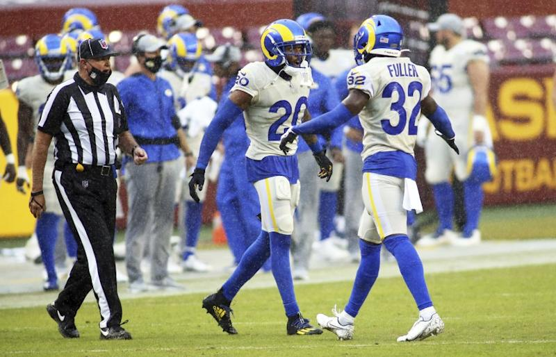 Los Angeles Rams cornerback Jalen Ramsey (20) and Los Angeles Rams strong safety Jordan Fuller (32) celebrate during an NFL football game against the Washington Football Team, Sunday, Oct. 11, 2020 in Landover, Md. (AP Photo/Daniel Kucin Jr.)