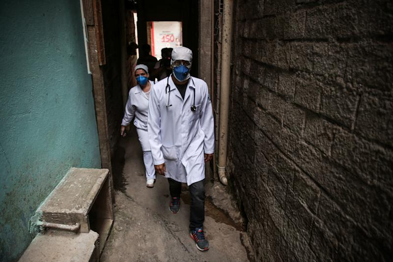 SAO PAULO, BRAZIL - APRIL 07: Ricardo Vieira, 41 years old surgeon walks on an alley of Paraisopolis favela on April 7, 2020 in Sao Paulo, Brazil. 'G10 Favelas' is a group formed by the ten richest communities (Favelas) in the country comprised of social impact leaders and entrepreneurs in favor of economic development and the protagonism of communities. Paraisopolis is the second largest favela in the city of Sao Paulo housing more than 100 thousand people. (Photo by Alexandre Schneider/Getty Images)
