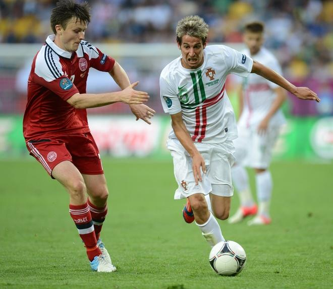 Portuguese defender Fabio Coentrao (R) vies with Danish midfielder William Kvist during the Euro 2012 championships football match Denmark vs Portugal on June 13, 2012 at the Arena Lviv. AFP PHOTO / JEFF PACHOUDJEFF PACHOUD/AFP/GettyImages