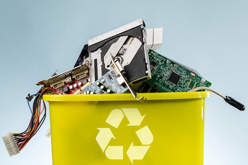 recycling bin filled with electronics