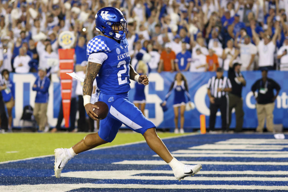 Kentucky running back Chris Rodriguez Jr. (24) runs the ball into the end zone for a touchdown during the second half of an NCAA college football game against Florida in Lexington, Ky., Saturday, Oct. 2, 2021. (AP Photo/Michael Clubb)