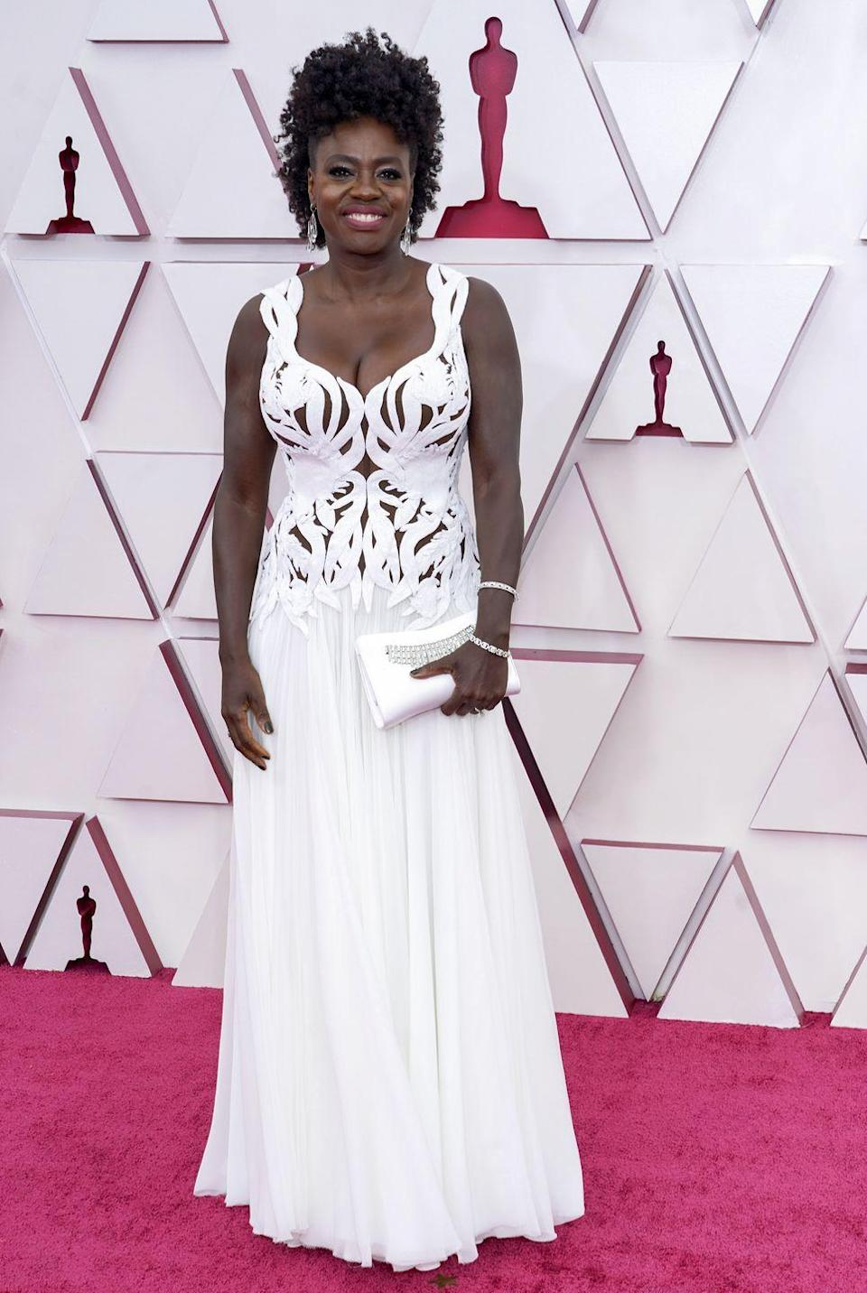 <p>Wearing bespoke Alexander McQueen and jewels by Forevermark.</p>