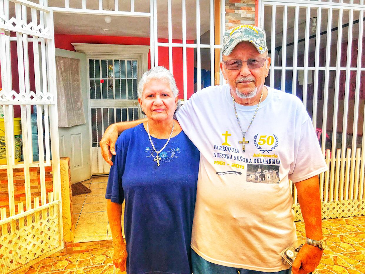 Ramona and Santos Lopez Caraballo stand outside their home in Arecibo, Puerto Rico, on Oct. 10, 2017. The couple had no cell service or other communication for 15 days after Hurricane Maria hit. (Photo: Caitlin Dickson/Yahoo News)