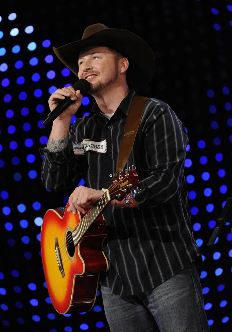 """FILE - This file photo originally provided by NBCUniversal shows Timothy Michael Poe on the talent competition show """"America's Got Talent,"""" on the episode that aired on June 4, 2012. The singing soldier whose claims of being injured in battle were rejected by military officials won't be advancing on """"America's Got Talent."""" (AP Photo/NBC, Virginia Sherwood)"""