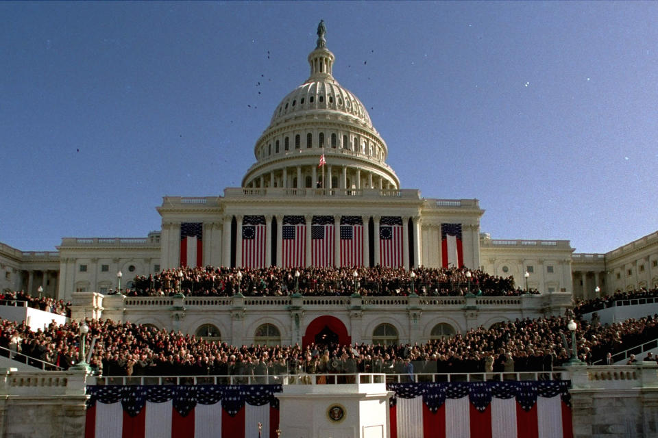 Thousands gather on Capitol Hill on Jan. 20, 1993, as President Clinton takes the oath of office as the 42nd president of the United States. (AP Photo/Ron Edmonds)