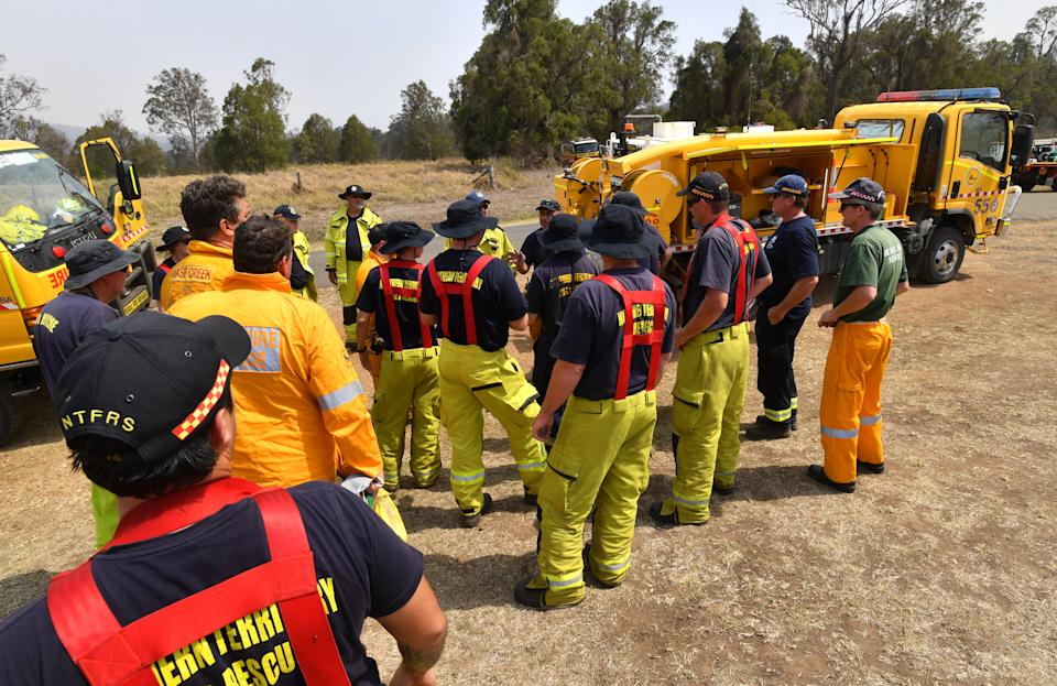Rural firefighters prepare for another exhausting day at Spicers Gap, south west of Brisbane yesterday. Source: AAP
