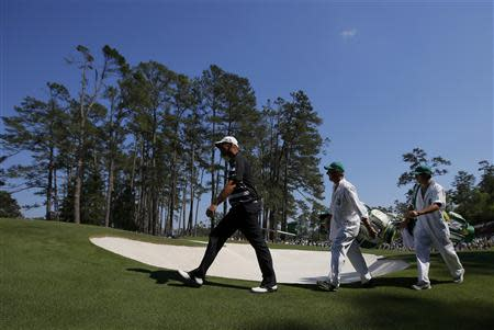 Denmark's Thomas Bjorn walks to the sixth green during the third round of the Masters golf tournament at the Augusta National Golf Club in Augusta, Georgia April 12, 2014. REUTERS/Brian Snyder
