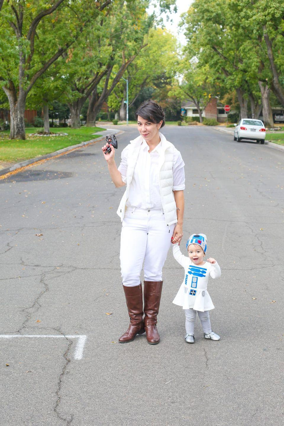 """<p>We're loving this easy (and cozy!) take on Princess Leia's signature look from <em>The Empire Strikes Back</em>. Accessorize with your tot dressed as an adorable R2-D2. </p><p><strong>Get the tutorial at <a href=""""https://lovelyindeed.com/how-to-make-a-family-star-wars-costume-for-halloween/"""" rel=""""nofollow noopener"""" target=""""_blank"""" data-ylk=""""slk:Lovely Indeed"""" class=""""link rapid-noclick-resp"""">Lovely Indeed</a>. </strong></p><p><strong><a class=""""link rapid-noclick-resp"""" href=""""https://www.amazon.com/XPOSURZONE-Packable-Lightweight-Outdoor-Puffer/dp/B01D34Q2NI/?tag=syn-yahoo-20&ascsubtag=%5Bartid%7C10050.g.21287723%5Bsrc%7Cyahoo-us"""" rel=""""nofollow noopener"""" target=""""_blank"""" data-ylk=""""slk:SHOP WHITE VESTS"""">SHOP WHITE VESTS</a><br></strong></p>"""