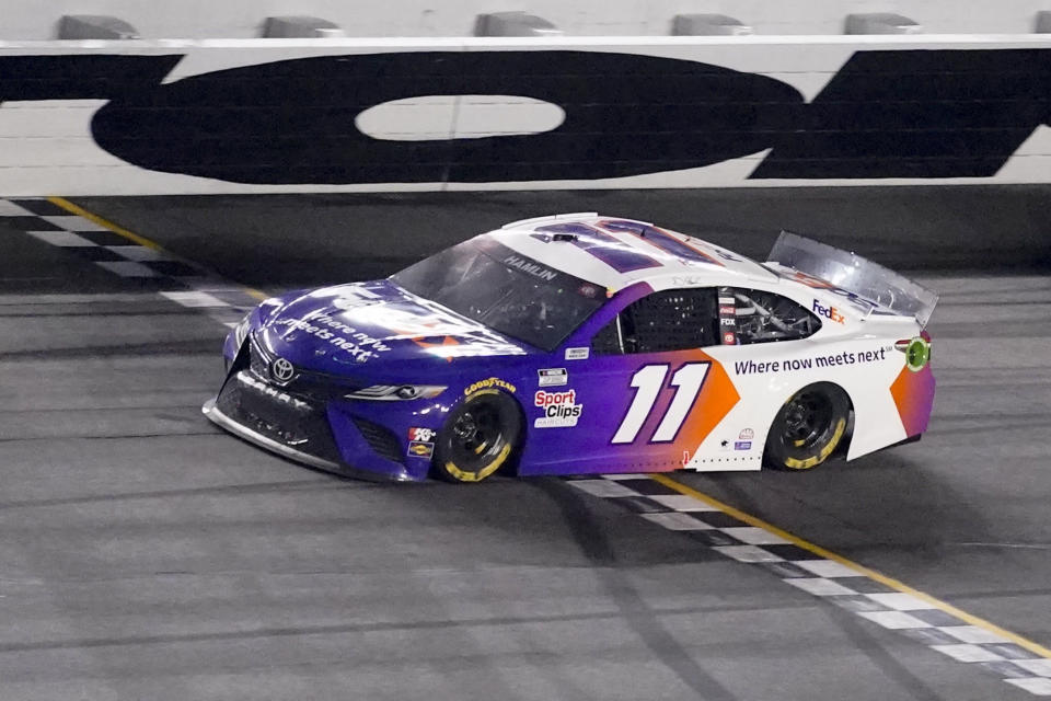 Denny Hamlin wins the first stage during the NASCAR Daytona 500 auto race at Daytona International Speedway, Sunday, Feb. 14, 2021, in Daytona Beach, Fla. (AP Photo/John Raoux)