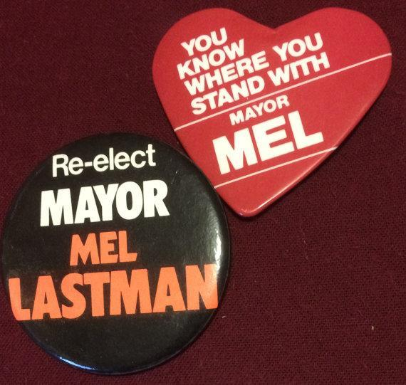 """<p>Two vintage buttons from one of Mel Lastman's re-election campaigns. Lastman served as a mayor for more than 30 years, first in North York then the amalgamated Toronto until 2003. Who's better than Bad Boy? <a href=""""http://etsy.me/2fLGWoM"""" rel=""""nofollow noopener"""" target=""""_blank"""" data-ylk=""""slk:Etsy"""" class=""""link rapid-noclick-resp"""">Etsy</a> </p>"""