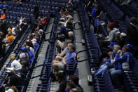 Fans wear masks and sit in marked off seats at an NCAA college basketball game in the Southeastern Conference Tournament Thursday, March 11, 2021, in Nashville, Tenn. Large buildings with high ceilings and ventilation systems that can change out fresh air almost a third as well as airplanes are reasons why experts and engineers believe it's reasonable for limited numbers of fans to be returning to live, indoor sporting events. They say masks are still necessary, but most professional and big college arenas like the ones that host NHL and NBA games and the NCAA Tournament have the capacity to make it work and keep people from spreading the coronavirus. (AP Photo/Mark Humphrey)