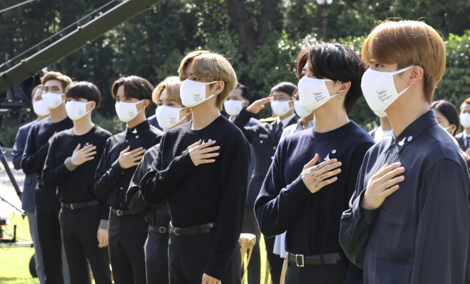 South Korean K-pop group BTS members salute to their national flag during a ceremony marking the National Youth Day at the presidential Blue House in Seoul, South Korea, Saturday, Sept. 19, 2020. (Lee Jin-wook/Yonhap via AP)