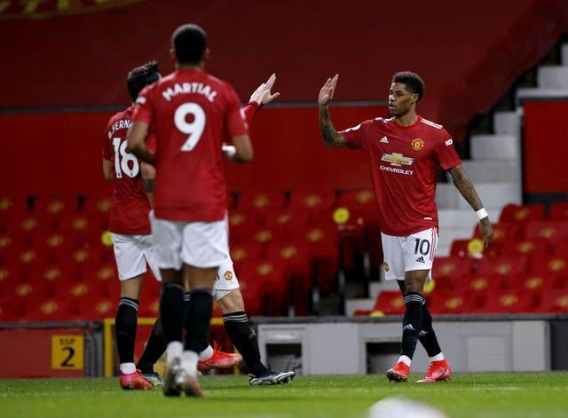 Marcus Rashford celebrates scoring Manchester United's opener on Sunday