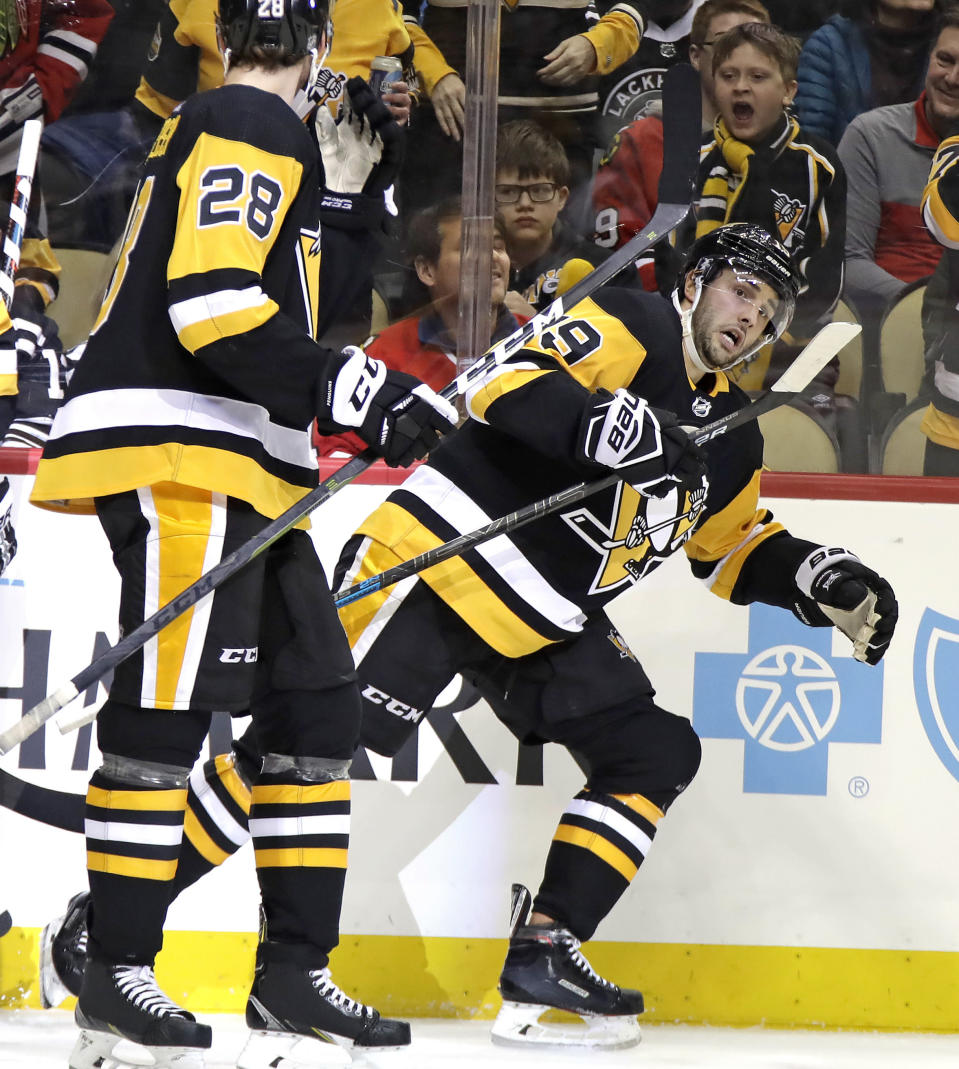 Pittsburgh Penguins' Derick Brassard (19) heads back to his bench after scoring during the second period of an NHL hockey game against the Chicago Blackhawks in Pittsburgh, Sunday, Jan. 6, 2019. (AP Photo/Gene J. Puskar)