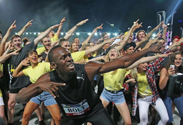 <p>Usain Bolt celebrates after winning the Mens 150 Metre Race during the Melbourne Nitro Athletics Series at Lakeside Stadium </p>