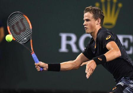 Mar 11, 2017; Indian Wells, CA,  Vasek Pospisil (CAN) hits a ball as he defeated Andy Murray (not pictured) in his 2nd round match in BNP Paribas Open at the Indian Wells Tennis Garden. Pospisil won 6-4, 7-6. Mandatory Credit: Jayne Kamin-Oncea-USA TODAY Sports