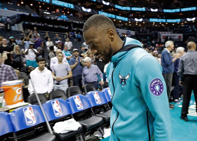 Charlotte Hornets' Kemba Walker leaves the court after the team's game against the Orlando Magic in Charlotte, N.C., in April. (AP Photo/Chuck Burton)