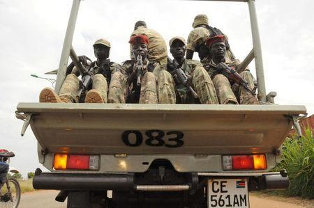 South Sudan National security members ride on their truck as they protect internally displaced people during a reallocation at the United Nations Mission in South Sudan (UNMISS) compound at the UN House in Jebel, in South Sudan's capital Juba, August 31, 2016. REUTERS/Jok Solomun