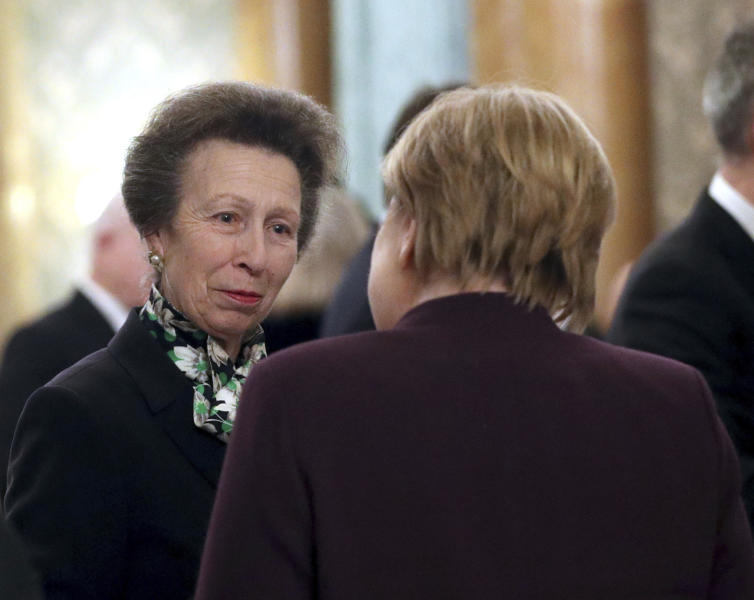 "FILE - In this Dec. 3, 2019 file photo, Britain's Princess Anne, left, talks to the Chancellor of Germany Angela Merkel during a reception at Buckingham Palace, as NATO leaders gather to mark 70 years of the alliance, in London.  A shorter video shows Britain's Queen Elizabeth II reprimanding her daughter Princess Anne for not greeting President Donald Trump at a NATO reception at Buckingham Palace. Princess Anne had already escorted President Donald Trump and wife, Melania, to shake hands with the monarch when the queen turned and looked at her daughter. ""It's just me,"" Anne said, motioning that no more world leaders were left in the greeting line. A shorter version of the clip appears to show the queen glaring at her daughter. A longer clip shows that Princess Anne walked in with Trump and the first lady.  (Yui Mok/Pool Photo via AP, File)"