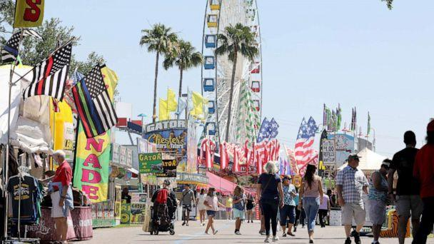PHOTO: Visitors to the Florida State Fair in 2021 tour a series of concessions and return on the opening day, April 22, 2021, at the Florida State Fairgrounds in Tampa, Fla.  (Douglas R. Clifford / Tampa Bay Times via ZUMA Wire)