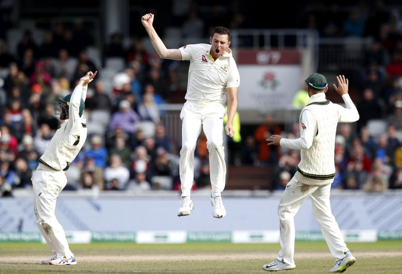 Australia's Josh Hazlewood celebrates taking the wicket of England's Jos Buttler during day five of the fourth Ashes cricket Test match at Old Trafford, Manchester, England, Sunday Sept. 8, 2019. (Martin Rickett/PA via AP)