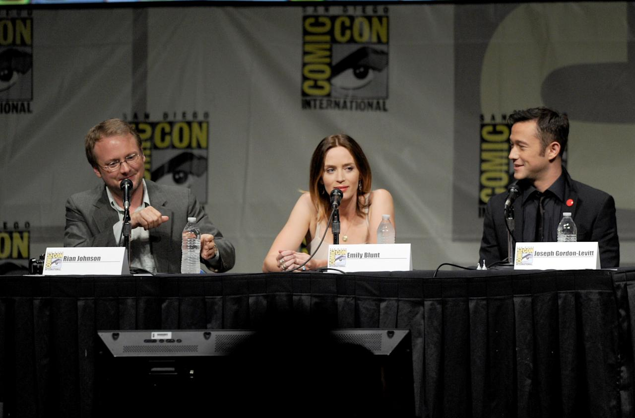"""SAN DIEGO, CA - JULY 13:  (L-R) Director Rian Johnson, actors Emily Blunt, and Joseph Gordon-Levitt speak during Sony's """"Looper"""" panel during Comic-Con International 2012 at San Diego Convention Center on July 13, 2012 in San Diego, California.  (Photo by Kevin Winter/Getty Images)"""