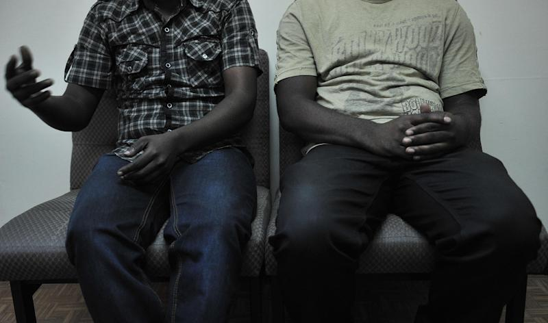 A gay couple pictured in Nairobi on January 12, 2012 after fleeing their home country