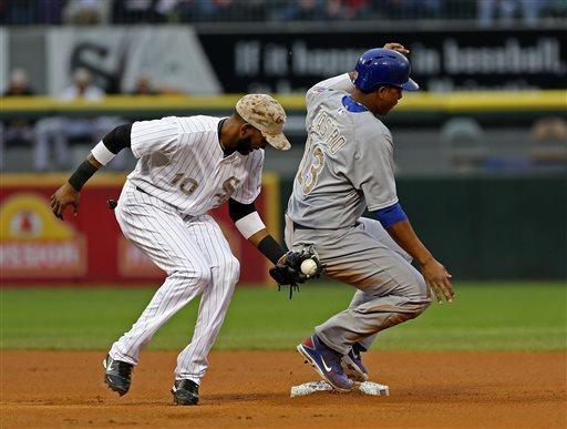 Chicago Cubs' Starlin Castro steals second base in the first inning. Chicago White Sox shortstop Alexei Ramirez is late with the tag in a baseball game in Chicago on Monday, May 27, 2013. (AP Photo/Charles Cherney)