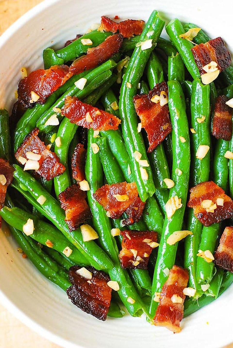 "<p>Save coveted oven space with this 30-minute <a href=""https://www.countryliving.com/food-drinks/g1547/green-bean-recipes/"" rel=""nofollow noopener"" target=""_blank"" data-ylk=""slk:veggie dish"" class=""link rapid-noclick-resp"">veggie dish</a> that's made on the stovetop. </p><p><strong>Get the recipe at <a href=""https://juliasalbum.com/garlic-and-bacon-green-beans/"" rel=""nofollow noopener"" target=""_blank"" data-ylk=""slk:Julia's Album"" class=""link rapid-noclick-resp"">Julia's Album</a>.</strong> </p>"
