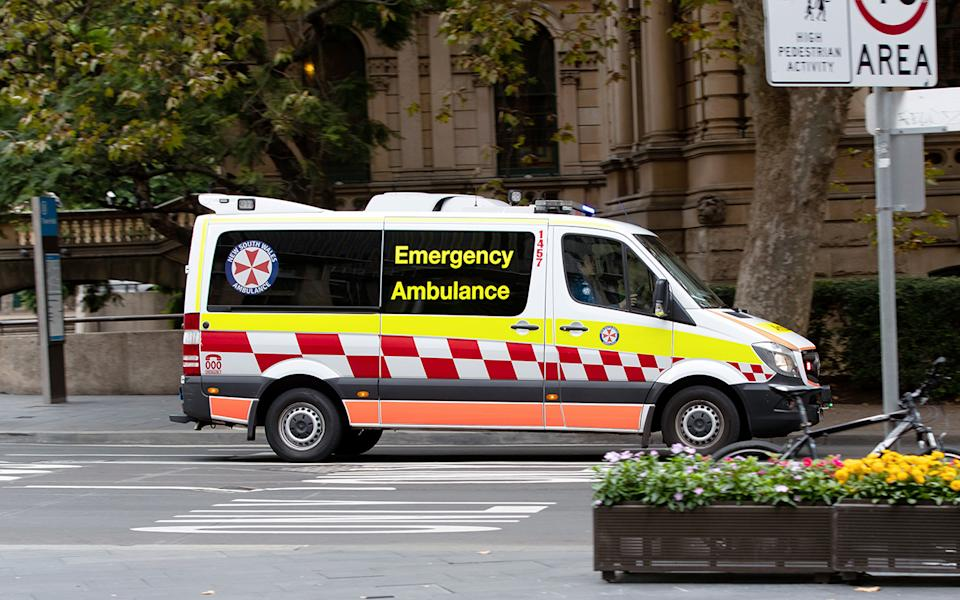 NSW Ambulance stopped on road. Source: Getty Images