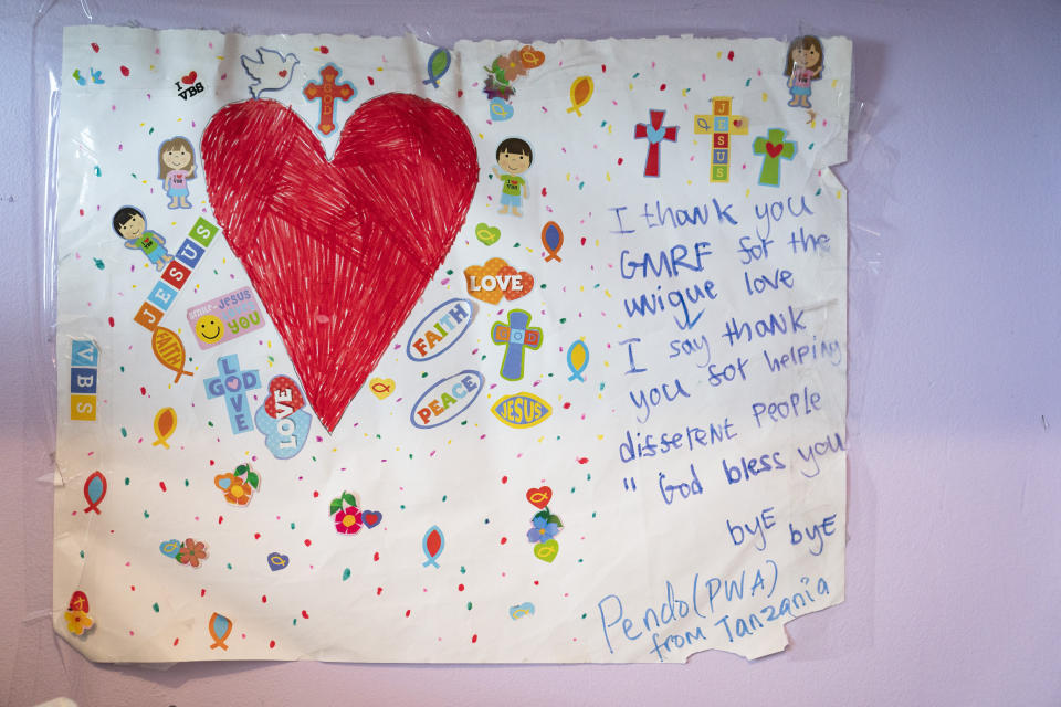 A thank you card written by Pendo Sengerena, a young amputee from Tanzania, hangs on the wall of Montanti's home office created from a walk-in closet, Tuesday, June 15, 2021, in the Staten Island borough of New York. Sengerema arrived in May through Elissa Montanti's charity The Global Medical Relief Fund for medical treatment. (AP Photo/John Minchillo)