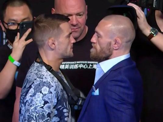 Dustin Poirier and Conor McGregor face off at Thursday's press conferenceBT Sport