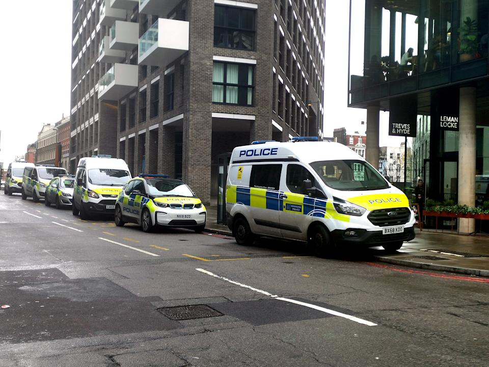 Police at the scene on Buckle Street, Whitechapel, east London, after a man died and another three were injured following a stabbing.