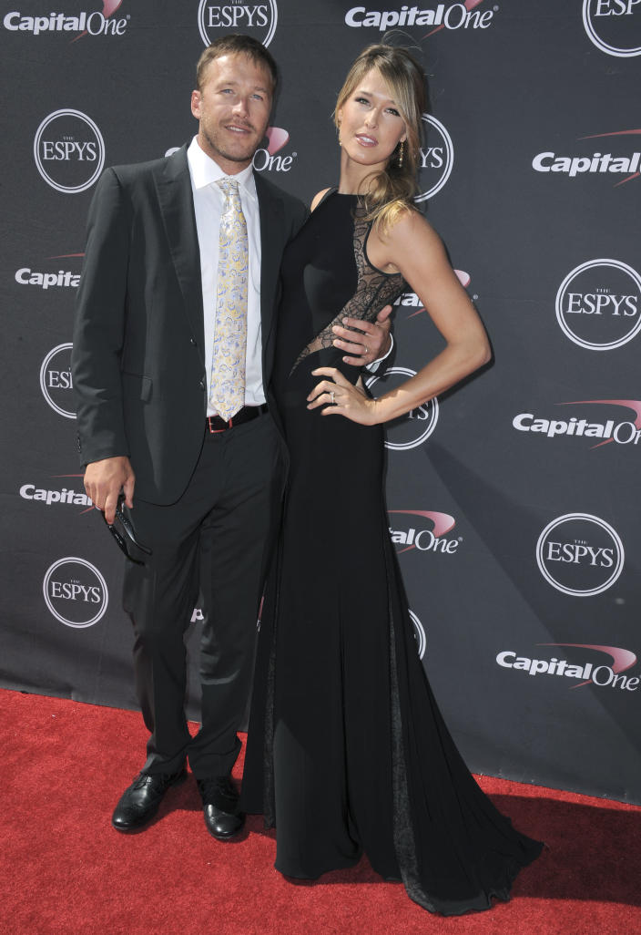 FILE- In this July 17, 2013 file photo, Skier Bode Miller, left, and wife Morgan Miller, arrive at the ESPY Awards in Los Angeles. Miller former girlfriend regained temporary custody of the couple's infant son until a New York court can decide which parent is more suitable to raise him. (AP Photo/Invision, Jordan Strauss)