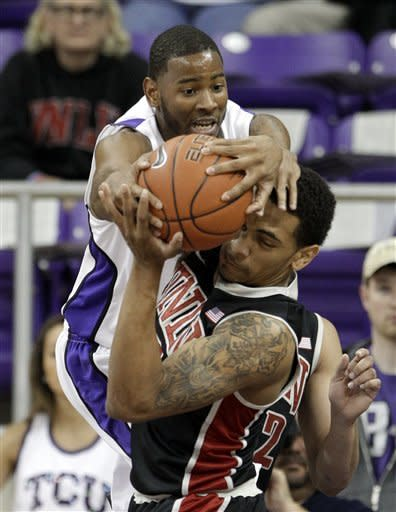 TCU 's Connell Crossland, rear, and UNLV 's Anthony Marshall, front, compete for a rebound in the first half of an NCAA college basketball game on Tuesday, Feb. 14, 2012, in Fort Worth, Texas. (AP Photo/Tony Gutierrez)