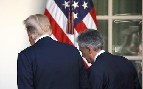 Donald Trump and Federal Reserve Chair Jerome Powell - Credit: Carlos Barria/REUTERS