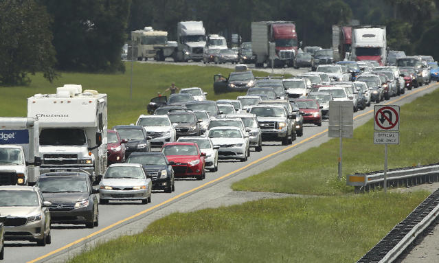 Motorists evacuate for the anticipated arrival of Hurricane Irma on the northbound lanes of Florida's Turnpike near the intersection of I-75 in Wildwood, Fla. on Friday, Sept. 8, 2017. (Stephen M. Dowell/Orlando Sentinel via AP)