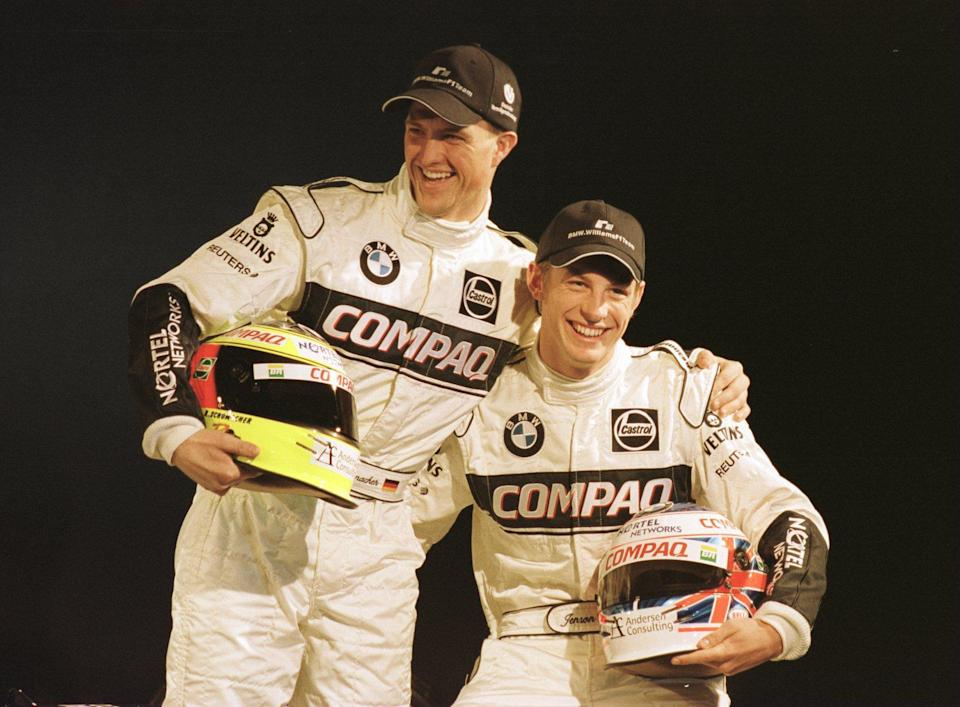 (L-R) Ralf Schumacher with new teammate Jenson Button enjoy a joke during the unveiling of the new car